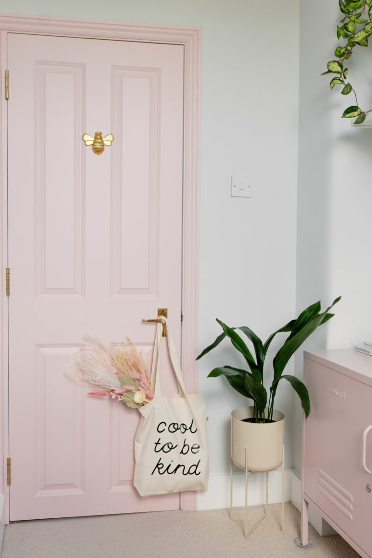 Pink interior office door with bee and cool to be kind tote bag