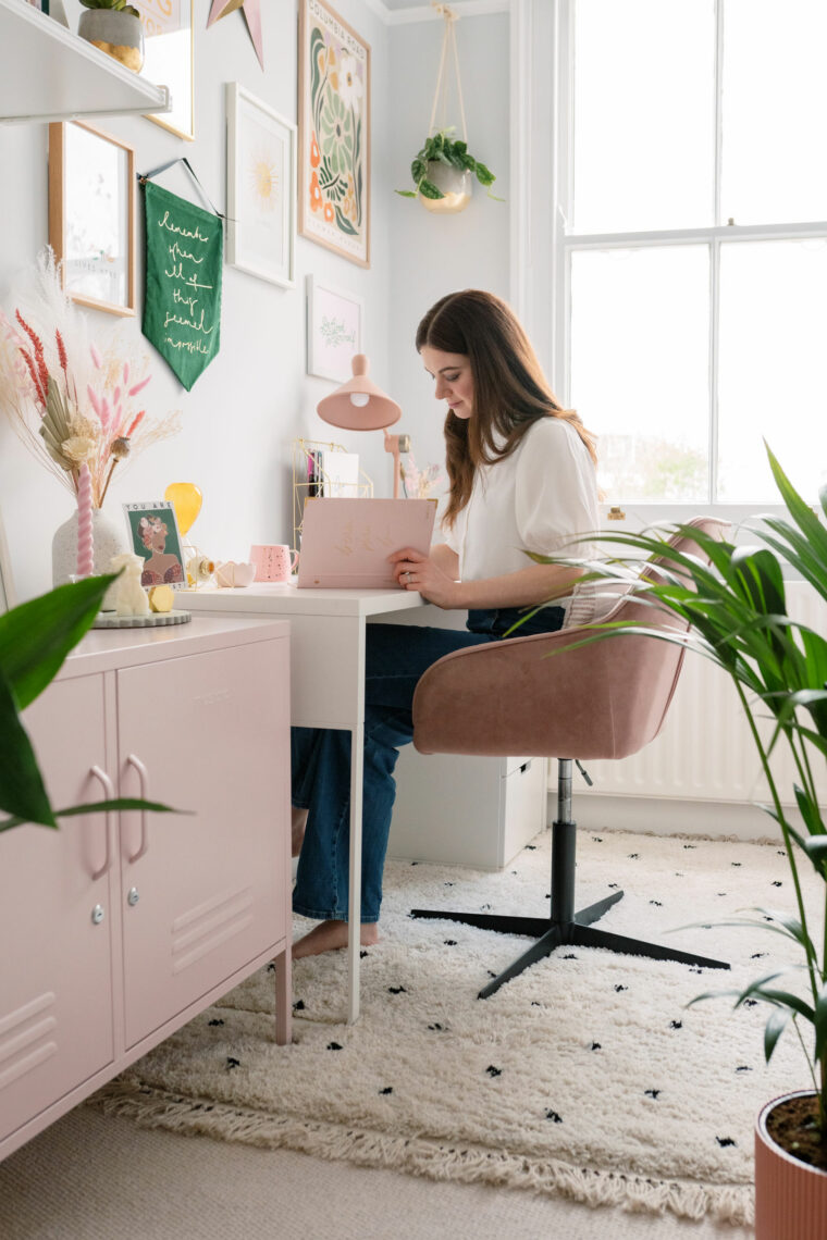 Girl working in beautiful home office surrounded by plants