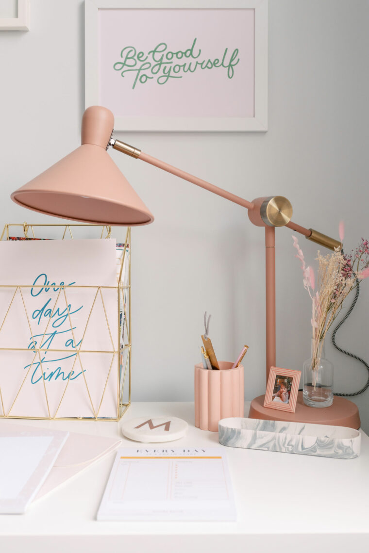 Pretty pink desk with pink desk lamp from Made.com, pink scallop pen pot, gold document organiser and desk pads.